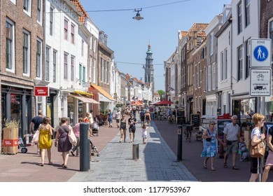Middelburg, Zeeland, NLD - JUN 30, 2018 - Shopping street 'Lange Viele' with in the background the 'Lange Jan' (Long John) church tower