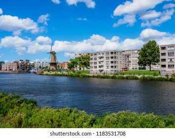 Middenkous Port and Windmill in Delfshaven, Rotterdam, South Holland, The Netherlands