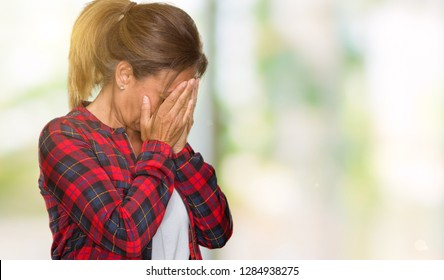 Middle age adult woman wearing casual jacket over isolated background with sad expression covering face with hands while crying. Depression concept.