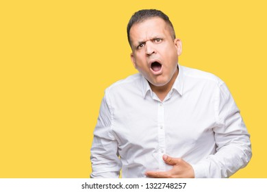 Middle age arab elegant man over isolated background In shock face, looking skeptical and sarcastic, surprised with open mouth