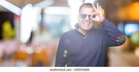 959e7e0791da Middle age arab man wearing sunglasses over isolated background doing ok  gesture with hand smiling