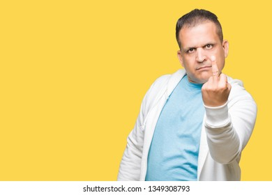 Middle age arab man wearing sweatshirt over isolated background Showing middle finger, impolite and rude fuck off expression