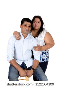 A middle age Asian couple in a close up image, the husband sitting and 