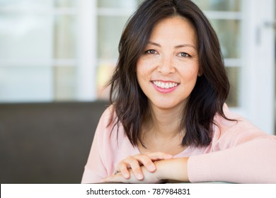 Middle age Asian woman.