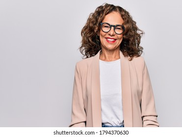 Middle age beautiful businesswoman wearing glasses standing over isolated white background with a happy and cool smile on face. Lucky person.