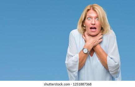 Middle age blonde business woman over isolated background shouting and suffocate because painful strangle. Health problem. Asphyxiate and suicide concept.
