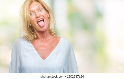 Middle age blonde business woman over isolated background sticking tongue out happy with funny expression. Emotion concept.