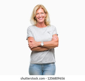 Middle age blonde woman over isolated background happy face smiling with crossed arms looking at the camera. Positive person.