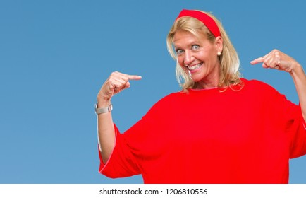 05d8d11a67f Middle age blonde woman over isolated background looking confident with  smile on face