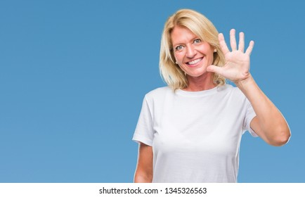Middle age blonde woman over isolated background showing and pointing up with fingers number five while smiling confident and happy.