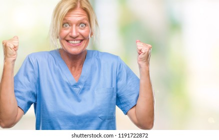 Middle age blonde woman wearing doctor nurse uniform over isolated background celebrating surprised and amazed for success with arms raised and open eyes. Winner concept.