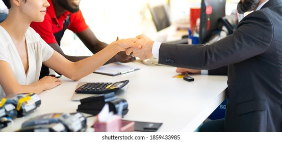 Middle age business man signing a contract