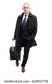 Middle age business man walking with carry on luggage isolated on white background