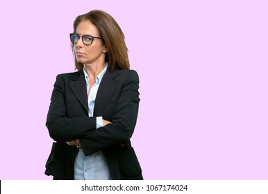 Middle age business woman irritated and angry expressing negative emotion, annoyed with someone