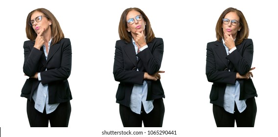 Middle age business woman thinking and looking up expressing doubt and wonder over white background