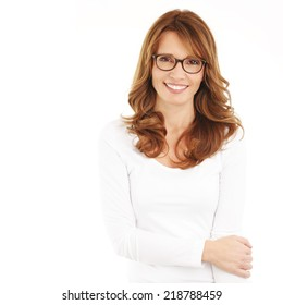 Middle age businesswoman standing against white background.