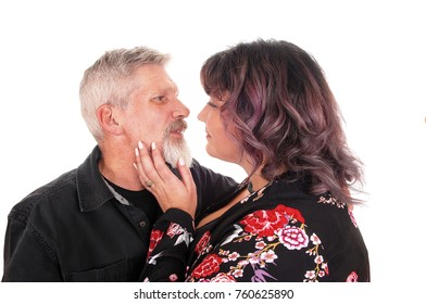 A middle age couple in a loving gesture in a close-up image, isolated for