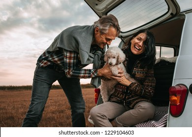Middle age couple with their dog at picnic