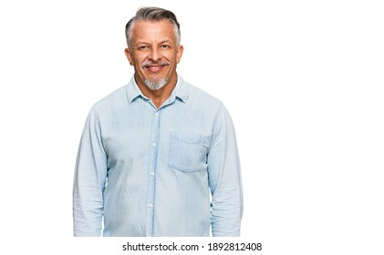 Middle age grey-haired man wearing casual clothes with a happy and cool smile on face. lucky person.