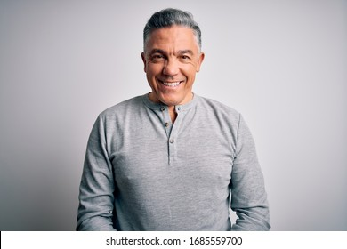 Middle age handsome grey-haired man wearing casual t-shirt over white background with a happy and cool smile on face. Lucky person.