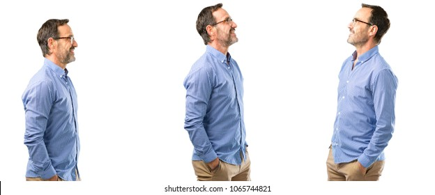 Middle age handsome man side view portrait over white background