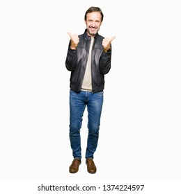 Middle age handsome man wearing black leather jacket success sign doing positive gesture with hand, thumbs up smiling and happy. Looking at the camera with cheerful expression, winner gesture.