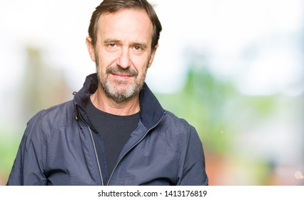 Middle age handsome man wearing a jacket Relaxed with serious expression on face. Simple and natural looking at the camera.