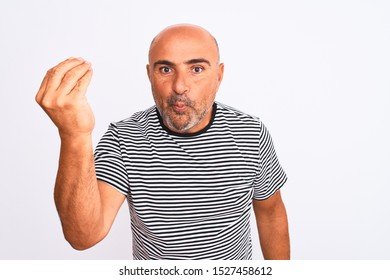 Middle age handsome man wearing striped navy t-shirt over isolated white background Doing Italian gesture with hand and fingers confident expression