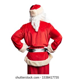 Middle age handsome man wearing Santa Claus costume and beard standing standing backwards looking away with arms on body