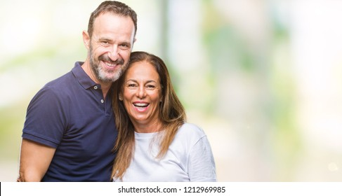 Middle age hispanic casual couple over isolated background with a happy and cool smile on face. Lucky person.