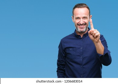 Middle age hoary senior man over isolated background showing and pointing up with finger number one while smiling confident and happy.