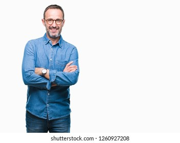 Middle age hoary senior man wearing glasses over isolated background happy face smiling with crossed arms looking at the camera. Positive person.