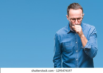 Middle age hoary senior man wearing glasses over isolated background feeling unwell and coughing as symptom for cold or bronchitis. Healthcare concept.