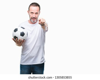 Middle age hoary senior man holding soccer football ball over isolated background pointing with finger to the camera and to you, hand sign, positive and confident gesture from the front