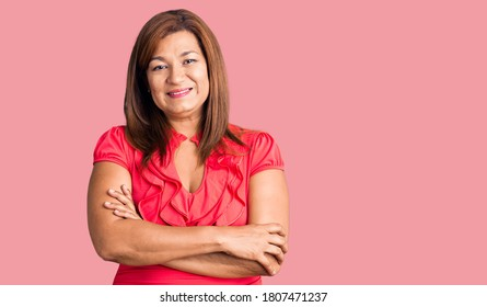 Middle age latin woman wearing casual clothes happy face smiling with crossed arms looking at the camera. positive person.
