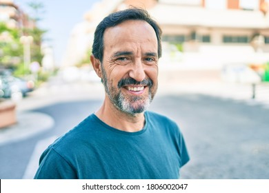 Middle age man with beard smiling happy outdoors