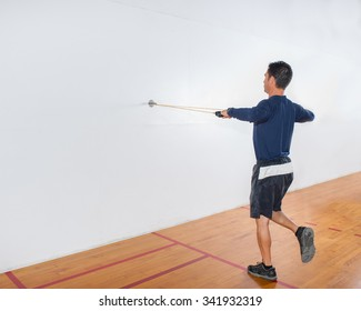 Middle age man demonstrates single leg rear deltoid strength exercise at end position.