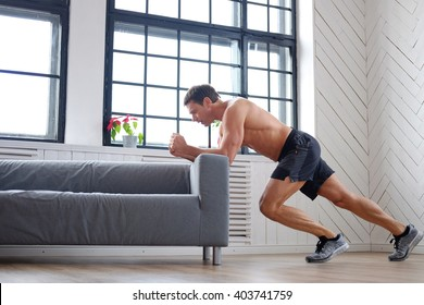 Middle age man doing fitness workouts at home.