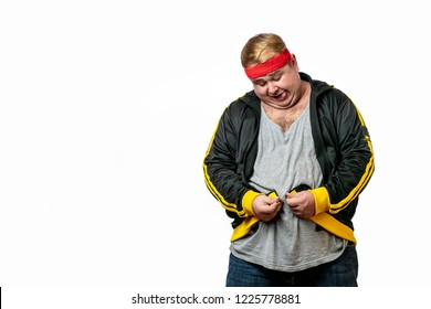 Middle age man with excess fat on his stomach tries to fasten sport jacket.
