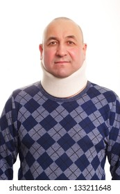 Middle age man with neck troubles using a cervical collar isolated on white background