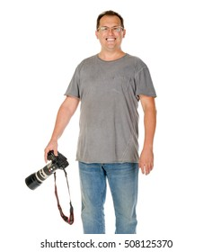 Middle age man portrait with dslr camera and big tele lens isolated on white
