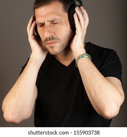 Middle age man vibrating with music/ Great Music Moment