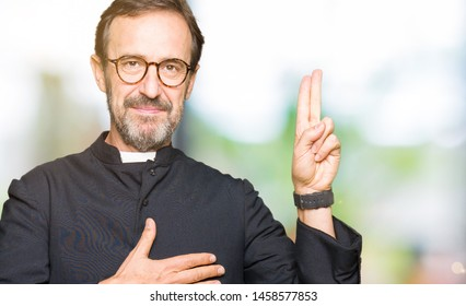 Middle age priest man wearing catholic robe Swearing with hand on chest and fingers, making a loyalty promise oath