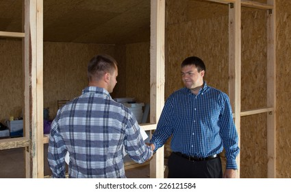 Middle Age Professional Engineer Men Showing Handshake at Building Site. Emphasizing Approved Project Proposal.