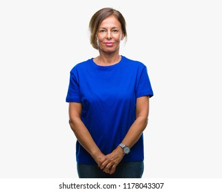Middle age senior hispanic woman over isolated background skeptic and nervous, frowning upset because of problem. Negative person.