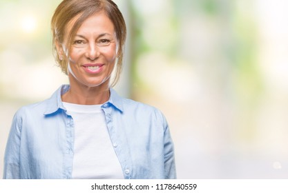 Middle age senior hispanic woman over isolated background with a happy and cool smile on face. Lucky person.