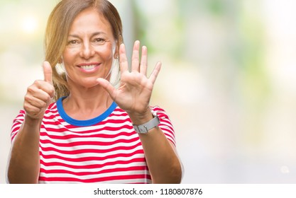 Middle age senior hispanic woman over isolated background showing and pointing up with fingers number six while smiling confident and happy.