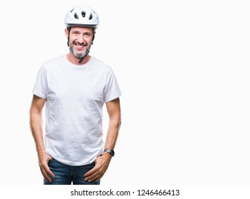 Middle age senior hoary cyclist man wearing bike safety helment isolated background with a happy and cool smile on face. Lucky person.