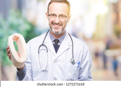 Middle age senior hoary doctor man holding neck collar over isolated background with a happy face standing and smiling with a confident smile showing teeth