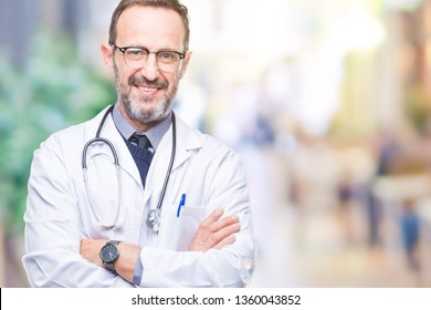Middle age senior hoary doctor man wearing medical uniform isolated background happy face smiling with crossed arms looking at the camera. Positive person.